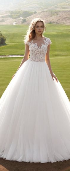 Graceful Tulle Sheer Jewel Neckline Ball Gown Wedding Dress With Lace Appliques
