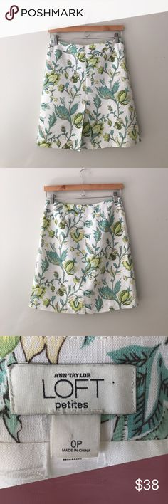 """LOFT Floral Front Vented Skirt Beautiful multi-green floral front vented skirt by Ann Taylor LOFT. Side zipper with hook and eye closure. 55% linen 45% rayon. Fully lined in 100% acetate. Waist: 28"""" length:  18 1/2"""" Hips: 17"""" across the front. Size 0P. Like new. LOFT Skirts A-Line or Full"""