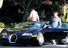Simon Cowell's $1.2 million Black Bugatti Veyron. Rubbish fashion choice- however exceptional car choice!