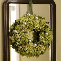 Double the Drama | Try hanging a wreath on a mirror in your home. The reflection adds depth and interest. | SouthernLiving.com
