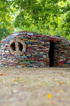 Petite Planet: A House Made Of Books & A Rainbow Library