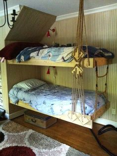 Look what Grandpa Thurman built Blake during his visit here last month!  I wanted to do hanging beds in Blake's room, and my dad built exactly what I'd pictured.  Grandpa even made him a rope ladder to climb to the second bunk.  Grandpa is a sailor and loved designing the block and rigging to finish the 'nautical' look for our little pirate-lover.  I did a tan wash on the wood so it would match the beadboard walls and installed some little red reading lights from Ikea.  They're a low wattage…