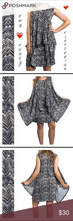 Flowy Funky Flattering Front Ruffle Dress SMLXL❤️ How I love this amazingly fun, flowy, funky & flattering dress❤️Front ruffle hides flaws and adds tons of flare. Black & white chevron-like design. Great stretch 60% polyester/ 40% cotton (no wrinkles) True to size (misses)❤️❤️❤️ Dresses Midi