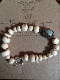 hand crafted drilled bone beads, Thai silver and turquoise charm bracelet, set on sturdy wire with sterling clasp. made for women or men, this is a