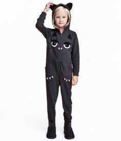 Dark gray/cat. Jumpsuit in thick slub jersey with a lined hood. Zip and printed motif at front, long sleeves, side pockets, and ribbing at cuffs and hem.