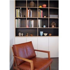 Cabinetry form ply formply black matte bookshelf shelf + leather chair timber mcm boomerang