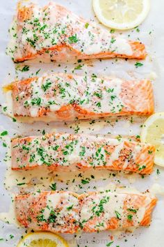Oven Baked Salmon with flavorful and simple lemon cream sauce. Lemon beurre blanc, will be your secret weapon for seafood recipes. Gourmet flavors at . Baked Salmon Lemon, Oven Baked Salmon, Baked Salmon Recipes, Baked Fish, Fish Recipes, Seafood Recipes, Cooking Recipes, Oven Recipes, Recipes Dinner
