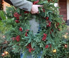 Make Your Own Pine Wreaths - Why buy freah pine wreaths when you can make them in a matter of minutes? Collect free scraps from tree lots and wire the scraps on…