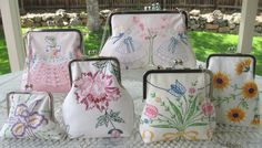 Framed handbags, purses, made with vintage embroidered linens....... so pretty!