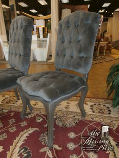 The Laurel chair in a tufted grey velvet set on an antique, rubbed wood frame. Gorgeous French style legs and rich fabric. Perfect for a formal dining table. Retails for $737 each new. Two available at time of posting.