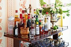 A stylish home bar is the best way to keep your ready for an impromptu party. See the chic home bar designs of some of our favorite tastmakers Caves, Martini, Historic Homes For Sale, Home Bar Designs, Small Bars, Bar Games, Alcohol, Atlanta Homes, Love Home