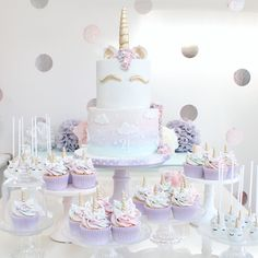 Pastel rainbow unicorn dessert table by Wish Upon a Cupcake