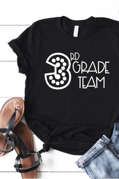 This grade level teacher tee is designed for 3rd grade teachers and assistants! Available in a variety of colors to meet your style and needs, this 3rd grade team tee is needed in your collection. Designed with third grade in mind, you'll love this teaching t-shirt!
