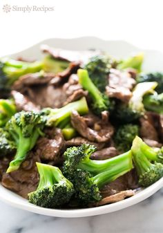 Chinese Broccoli Beef! Thinly sliced beef, marinated and quickly stir-fried with garlic and blanched broccoli. So EASY! ~ On SimplyRecipes.com