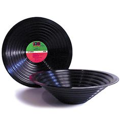 Great use for old records...  Put them over a metal bowl, put it in the oven, and watch it melt to whatever shape you want!