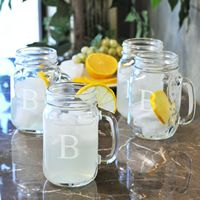 Mason Jars with last initial - great gifts!  cute drink glasses for a country themed wedding