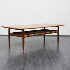 Anonymous; Walnut and Leather Coffee Table by Glostrup, 1960s.