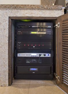 Rack 2 - Two DVRs and a Samsung Blu-ray player supply the movies and TV shows to all the displays, managed by a 4x4 matrix switcher.