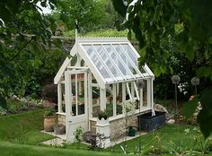 wooden_victorian_greenhouse - beautifully made and designed but so small you would soon be cursing yourself for not buying a bigger one!