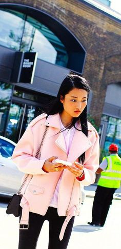 Jing Wen in a pink leather motorcycle jacket