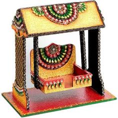 aapno rajasthan textured pooja jhula in wood & clay Wooden Art, Wooden Crafts, Clay Crafts, Home Crafts, Paper Crafts, Thali Decoration Ideas, Decoration For Ganpati, Coconut Decoration, Diy Crafts For Kids