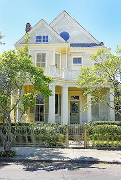 Cream with yellow trim, green shutters