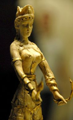 This figurine is a forgery, but still circulates as an authentic example of Cretan art. Not only the lack of craftsmanship but the modern look of the face give the fraud away. It didn't pass the C-14 dating test either.