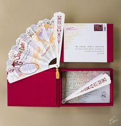 Stefania & Thomas Wedding Invitations.   This fun save-the-date was inspired by the rich culture and aesthetic heritage of Buenos Aires, Argentina, the bride's family home and wedding destination. Lush with curling gold and burgundy, a folding Argentine fan in laser-cut paper is hand-painted by Ceci, and decorated like the city's famous hand-painted signs.