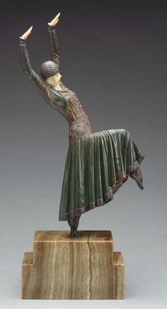 'VESTED DANCER', A PATINATED AND COLD-PAINTED BRONZE AND IVORY FIGURE - CAST AND CARVED FROM A MODEL BY DEMETRE H. CHIPARUS, CIRCA 1925.