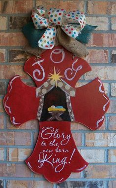 Christmas painted cross Door Hanger.                                                                                                                                                                                 More
