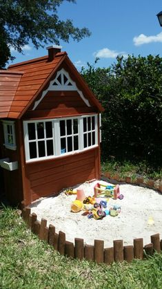 Playhouse and sandbox Costco cedar play house and sandbox built with weed blocker and cedar garden trim from lowes.