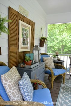 Repurpose old shutters as a backdrop for art and furniture on your porch. Here, they add another layer of texture behind a refined dresser.