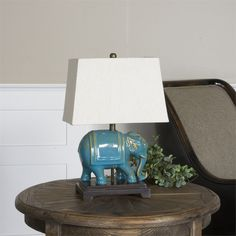 Pradesh Blue Ceramic Table Lamp Distressed Blue Ceramic Accented With Aged Ivory Undertones And Solid Mango Wood Details. The Rectangle Tapered Hardback Shade Is A Beige Linen Fabric. Elephant Lamp, Ceramic Elephant, Elephant Table, Elephant Fabric, Table Lamp Wood, Ceramic Table Lamps, Uttermost Mirrors, Uttermost Lighting, Barn Wood Picture Frames