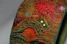 Monday mind-benders-When you take a close look at this new Encrusted polymer bracelet from Jana Roberts Benzon are you as mesmerized as I am? The colorful texture is sumptuous and mystifying. Polymer Clay Bracelet, Polymer Beads, Polymer Clay Art, Clay Beads, Mind Benders, New Thought, Cutwork, Oeuvre D'art, Jewelry Art