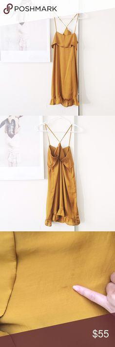 Anthropologie Slip Dress By Eloise. Very cute Golden yellow Slip dress with ruffled hem. In great condition, just a tiny mark shown in third pic. Not very noticeable. It's a great fall color! Wear it with a chunky sweater, tights, and accessorize with a belt! Please ask all questions before purchasing. No returns. No modeling. Size XS Anthropologie Dresses