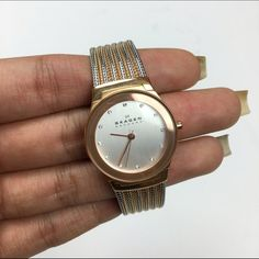 Skagen Rose Gold/Silver Watch 2-toned rose gold and silver watch from Skagen with mesh band. Beautiful and sleek watch that I only wore a few times. I favor bigger faced watches so I never gravitated towards this as much as I wanted to! Skagen Accessories Watches
