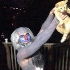 This wonderfully costumed man posing with his Simba. | The 49 Most WTF Pictures Of People Posing With Animals