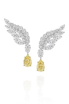 Harry Winston eagle earrings with two pear-shape fancy yellow diamonds and 42 pear-shape, marquise, and round brilliant diamonds in yellow gold and platinum high jewelry Here's What Harry Winston's New High Jewelry Looks Like Harry Winston, High Jewelry, Jewelry Bracelets, Women Jewelry, Diamond Chandelier Earrings, Diamond Tops, Morris, White Gold Jewelry, Gold Jewellery