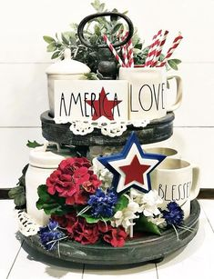 Honor Old Glory as it plays a big part in decor on a patriotic farmhouse tiered tray. Get ready for a little American Red, White & Blue pride! Easy elegant trays are perfect for of July decorating, memorial, flag, and labor day. Fun additions for pa Fourth Of July Decor, 4th Of July Decorations, House Decorations, July 4th, Memorial Day Decorations, Mason Jars, Independance Day, Succulent Centerpieces, Felt Ball Garland