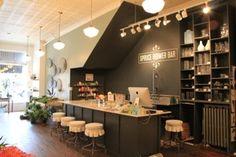 flower bar at spruce boutique florist shop <3 the bar stools, black, vintage school house lighting, decor <3