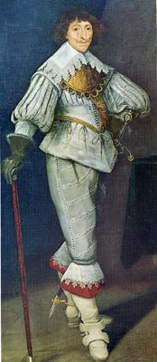 This Cavalier gentleman has a falling band style collar, most likely attached to his shirt. His doublet features paned sleeves, as well as paning in the upper torso. The peplum of his doublet is truly a series of wide pecadils (individual tabs attached at the waistline). His breeches--tapering to the knee--are softly constructed. He wears boots, which are the most common footwear for men during this period. His boots have a deep cuff just below the knee (most likely this is shown here in…