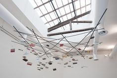 Richard Wentworth (1947- ), British / 'Firma Terra Firma Terra', 2009, Books, steel, and cable .... mobile of suspended books,