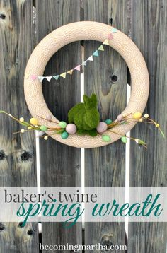 This spring wreath is wrapped in baker's twine and jazzed up with cute spring and easter decor. Learn how to make one for your door with this tutorial!