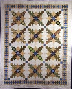 """The Sun Rays quilt is based on a favorite antique block. The quilt may be completed with seven fabrics or may be scrapped. I suggest using just one background fabric for continuity. On the cover quilt, I used a controlled scrap technique. For this technique, I used the same fabric in each of the main blocks, but used different fabrics for each of these blocks. (For example, I had 12 different Medium Tans – one for each block)  Size options include: Wall Hanging (34"""" x 34""""); Lap (66"""" x 82"""")"""