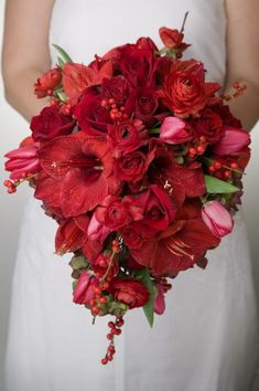 Solid red bridal bouquet   by Dorothy McDaniel's Flower Market