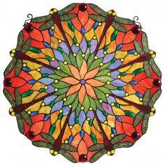 Image from http://smartshopbuy.com/images/HomeDecorations/dragonfly-art-glass.jpg.