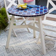 Add a little art to your space with the Mosaic Tiled Bistro Table. Its many ceramic tiles are carefully inlaid by hand onto an FSC®-certified hardwood base, for a unique look both indoors and out.