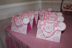 Pretty in Pink Purses {Favors} Easy DIY using paper bag & scrapbooking paper. Fill with pink nail polish, pearls, etc.