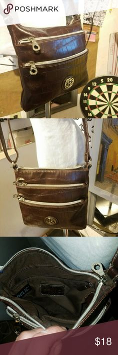 New without tags Relic crossbody Brown man-made leather crossbody by Relic new without tags with adjustable long strap Relic Bags Crossbody Bags