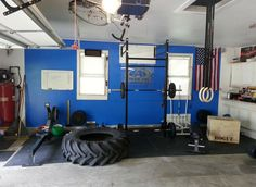 Nice and simple, clean garage gym with yet another giant tire!